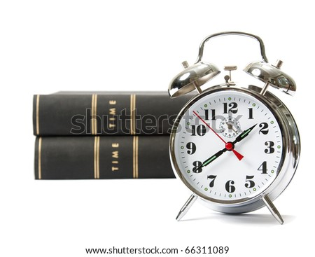 Analog clock and books