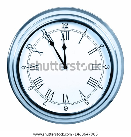 Analog clock showing five minutes to midnight or noon