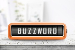 Analog device with the text buzzword on a wooden table in a bright living room