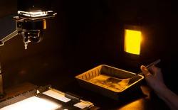 Analog photo printing. The photographer prints a black and white photograph