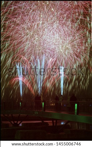 Analog Photography. Negative Film Scanned. Fireworks Festival. Pyrotechnics light up Montreal's winter. Fire on Ice at the Old Port. Montreal's Old Port is hosting free holiday fireworks in December.