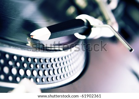 Analog record player spinning the disc with music