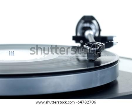 Analog turntable playing record.
