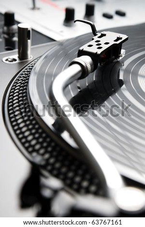 Analog turntable playing record with music