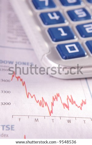 Analysing stock performance chart. Very shallow depth of field.