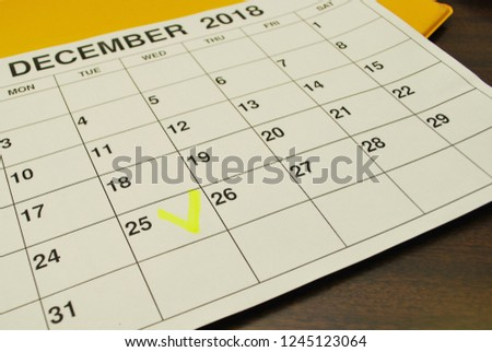 Analysis of a calendar and allocation of date December. December 2018 calendar printed out on a printer and lying on the table #1245123064