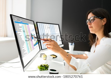 Analyst Working With Spreadsheet Business Data On Computer Stock photo ©