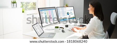 Analyst Working With Spreadsheet Business Data On Computer