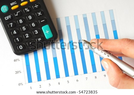 analyze a business chart with hand and pen - stock photo