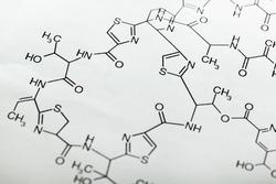 Analyzing, beaker, biochemist.