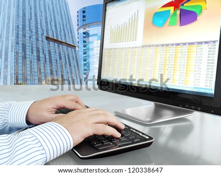 Analyzing Data on Computer Male Hands on the Keyboard in Front of Computer Screen with Financial Data and Charts