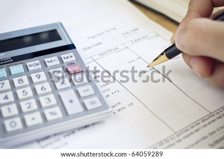 Analyzing invoice - stock photo