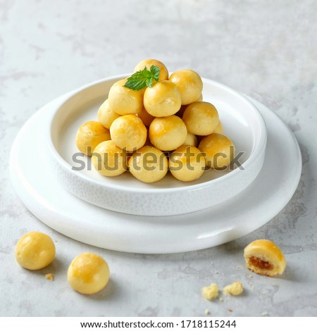 Ananas tart  or kue nastar in white plate and white background.