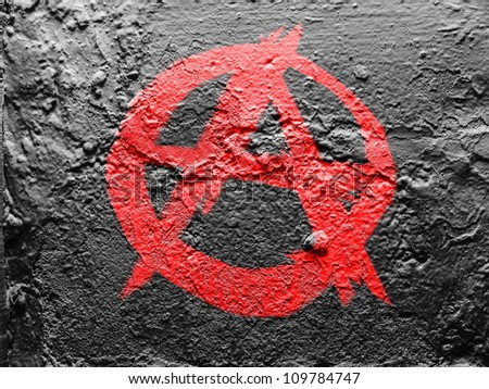 Anarchy symbol painted on grunge wall - stock photo