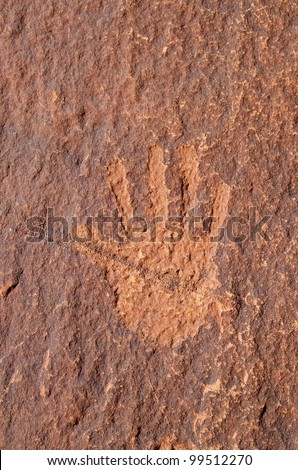 Anasazi petroglyph hand carved on a sandstone wall