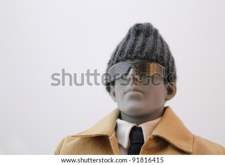 Anatomical artist manikin dressed in a coat, shirt and tie. - stock photo