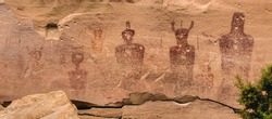Ancestral Puebloan or Anasazi petroglyphs of strange anthropomorph figures, often referred to as