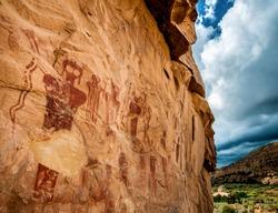 Ancestral Puebloan or Anasazi pictographs of strange anthropomorph figures, often referred to as