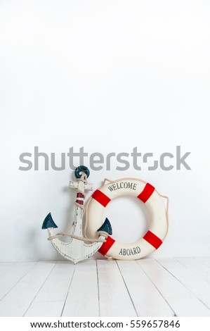 anchor and life buoy on a white ...