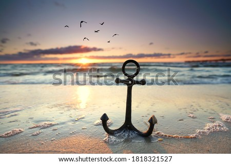 anchor at the beach with sunset light