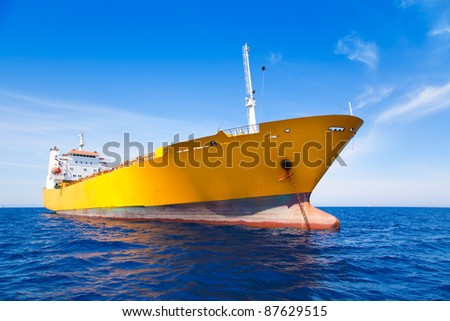 Anchor cargo yellow boat in blue sea under summer sky