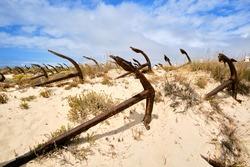 Anchor Cemetery of Santa Luzia - Portugal. Broken anchors along the sand dunes of Praia do Barril beach