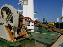 anchor chain on a bulk carrier is lashed and secured with wire rope