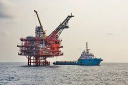 Anchor Handling Tug Supply (AHTS) Ship while operation and standby near petroleum platform