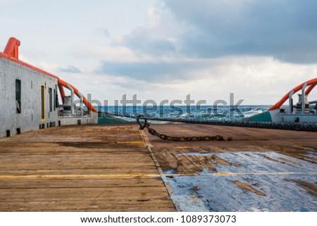 Anchor-handling Tug Supply AHTS vessel doing static tow tanker lifting. Ocean tug job.