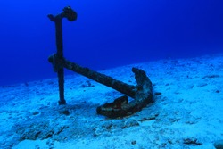 Anchor of old ship underwater on the bottom of the ocean