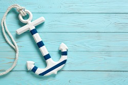 Anchor on a blue vintage wooden background.