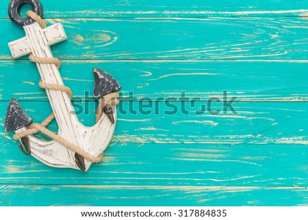 Anchor on Vintage Wooden Background