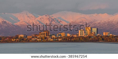 Anchorage, Alaska at sunset below the snowy Chugach Mountains