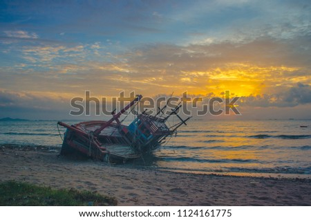 Anchored fishing boat on sandy beach of kating line beach. #1124161775