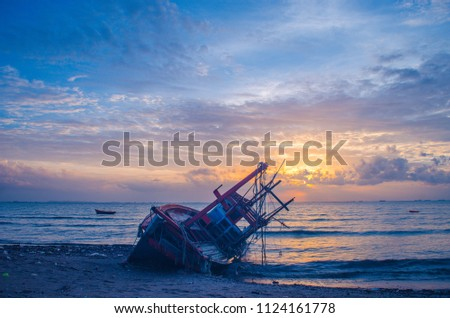 Anchored fishing boat on sandy beach of kating line beach. #1124161778