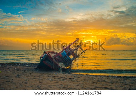 Anchored fishing boat on sandy beach of kating line beach. #1124161784