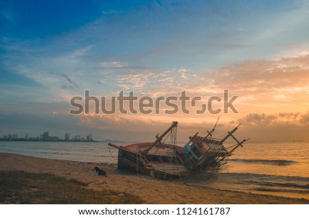Anchored fishing boat on sandy beach of kating line beach. #1124161787