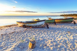 Anchored fishing boats on sandy beach of the Baltic Sea, Europe