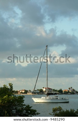 Anchored Sailboat in intercoastal waterway. Madeira Beach Florida - stock photo