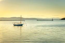 Anchored Sailing Boat at Sunset