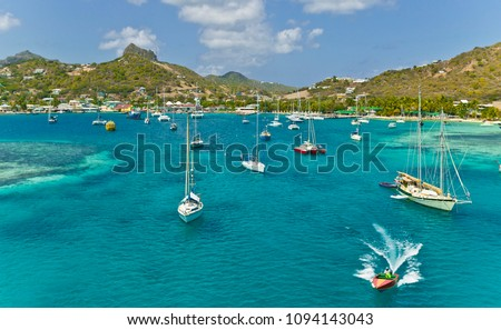 anchoring sailbooats in the shallow waters of Union Island,St.Vincent and Grenadines,West Indies #1094143043