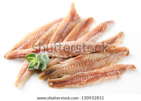 anchovy. Fillet with oregano on white