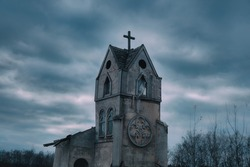 Ancient abandoned Church against a dark sky. Cityscape on Halloween, copy space