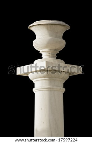 Ancient alike pillar with a flowerpot standing upon it