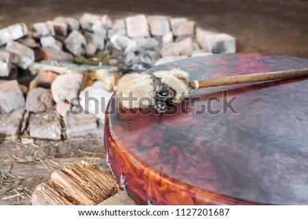 Ancient amerindian tambourine and drum drumstick replica.