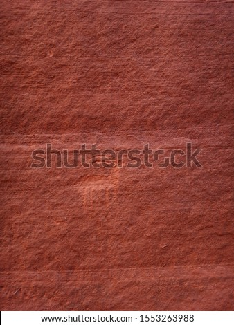 Ancient antelope petroglyph carved in red rock, Navajo Prehistoric Art Cave Painting in Buckskin Gulch canyon, Arizona