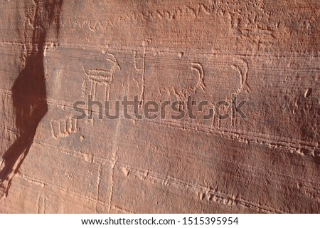 Ancient antelope petroglyphs carved in red rock, Navajo Prehistoric Art Cave Painting in Buckskin Gulch canyon, Arizona