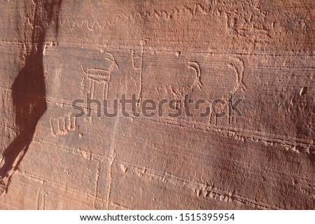 Ancient antelope petroglyphs carved in rock, Navajo Prehistoric Art Cave Painting in Buckskin Gulch canyon, Arizona