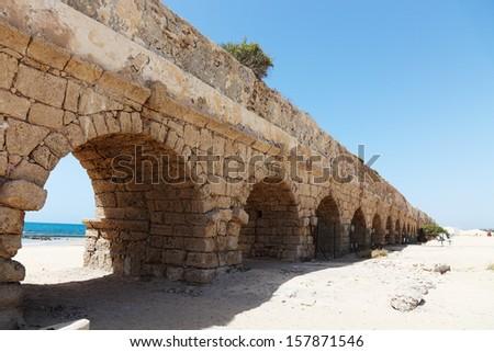 Ancient aqueduct at Caesarea. Israel
