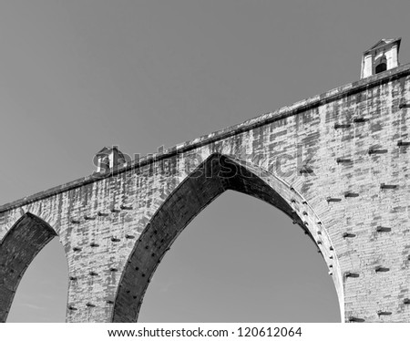 ancient aqueduct in the Lisbon built in 18th century, Portugal  (black and white)